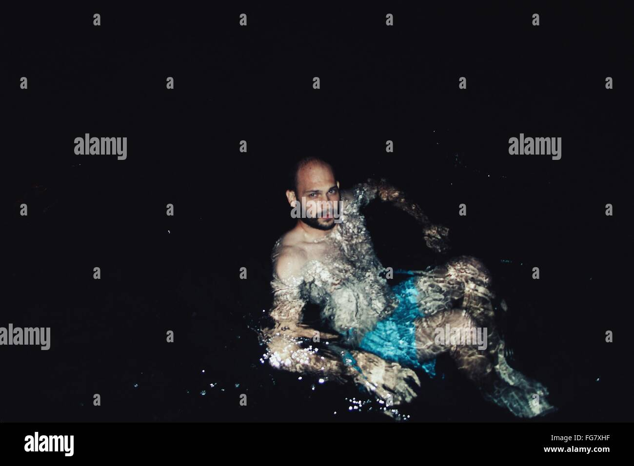 High Angle View Of Man Swimming At Lake - Stock Image