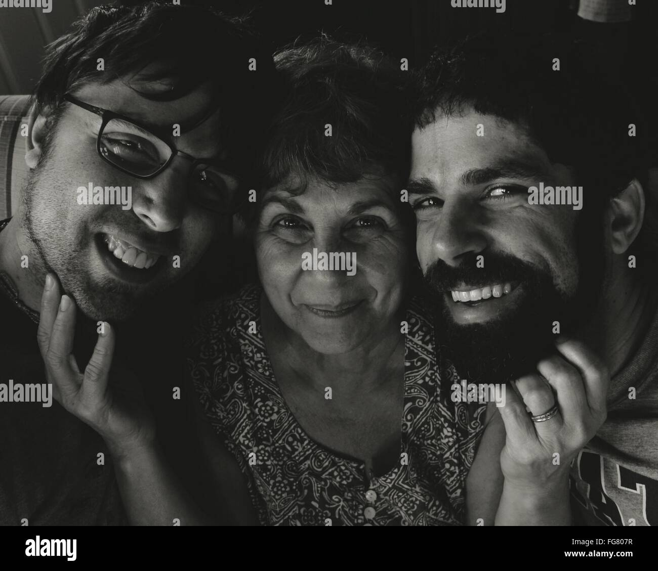 Portrait Of Happy Mother And Sons At Home - Stock Image