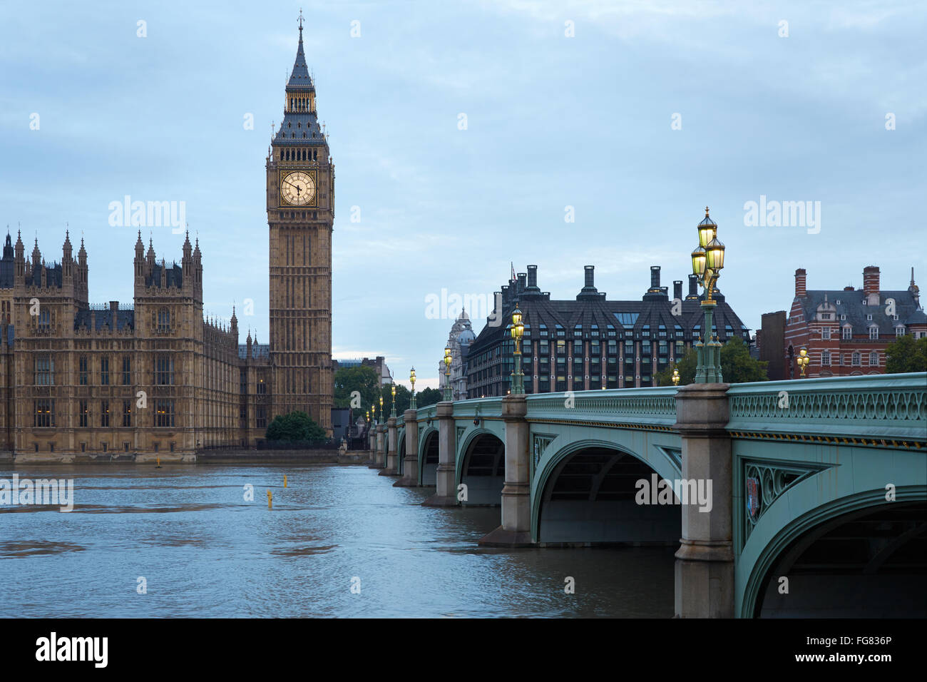 Big Ben and bridge in the early morning in London, natural colors and lights - Stock Image