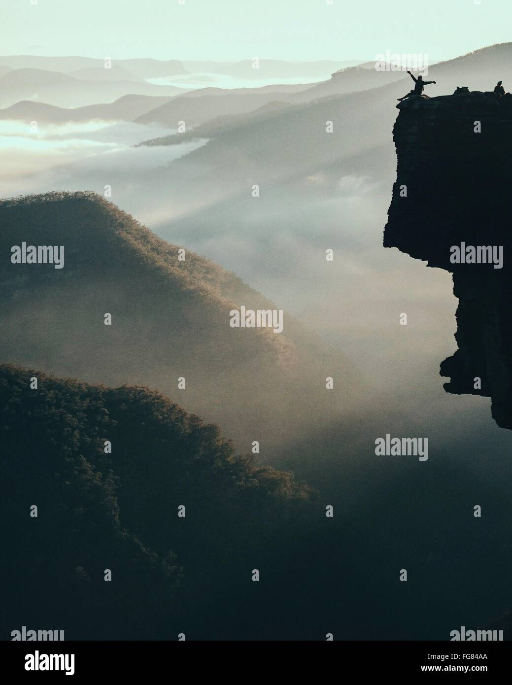 Scenic View Of Mountains During Foggy Weather - Stock Image