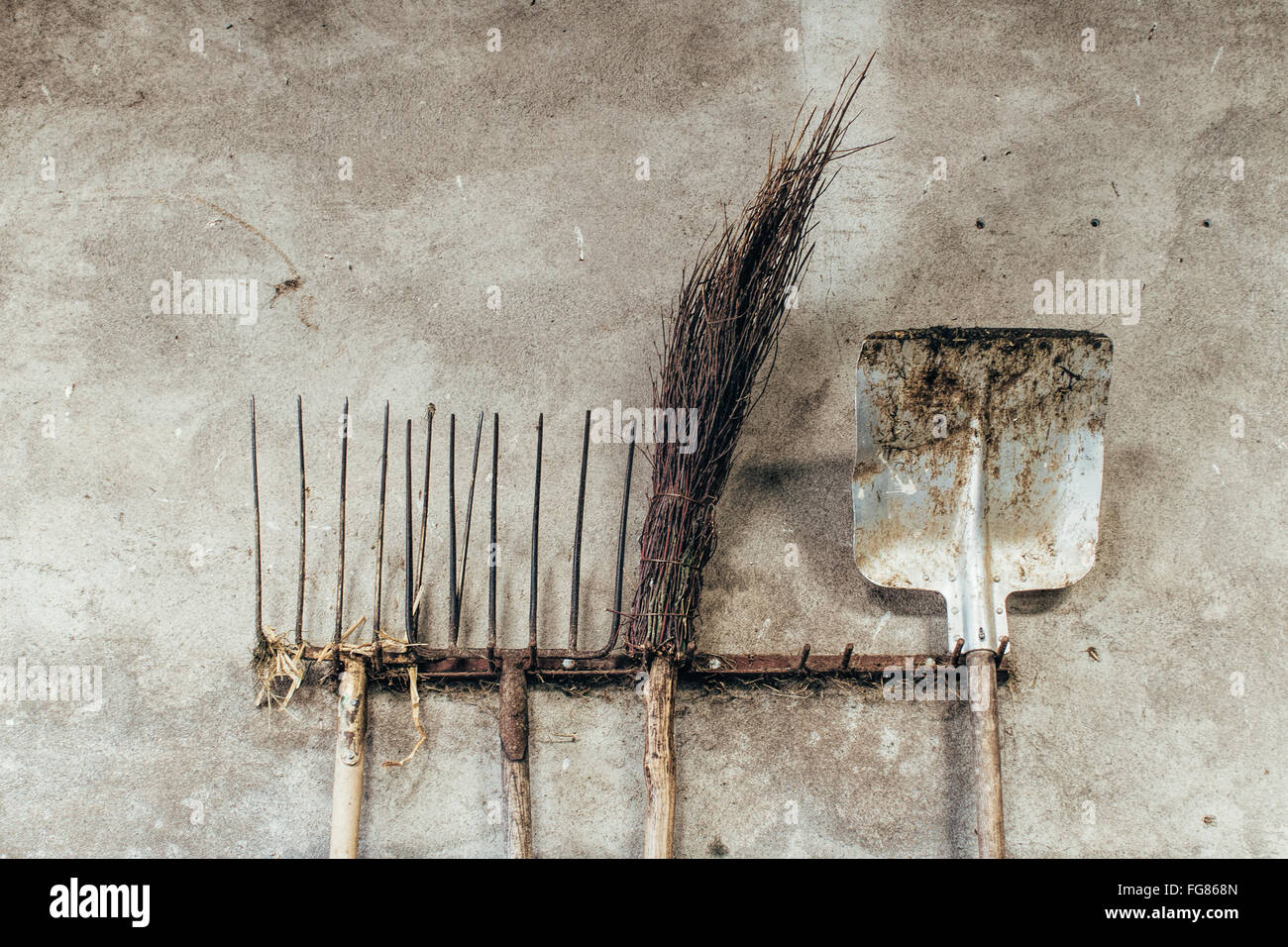 Gardening Equipment Hanging On Wall - Stock Image