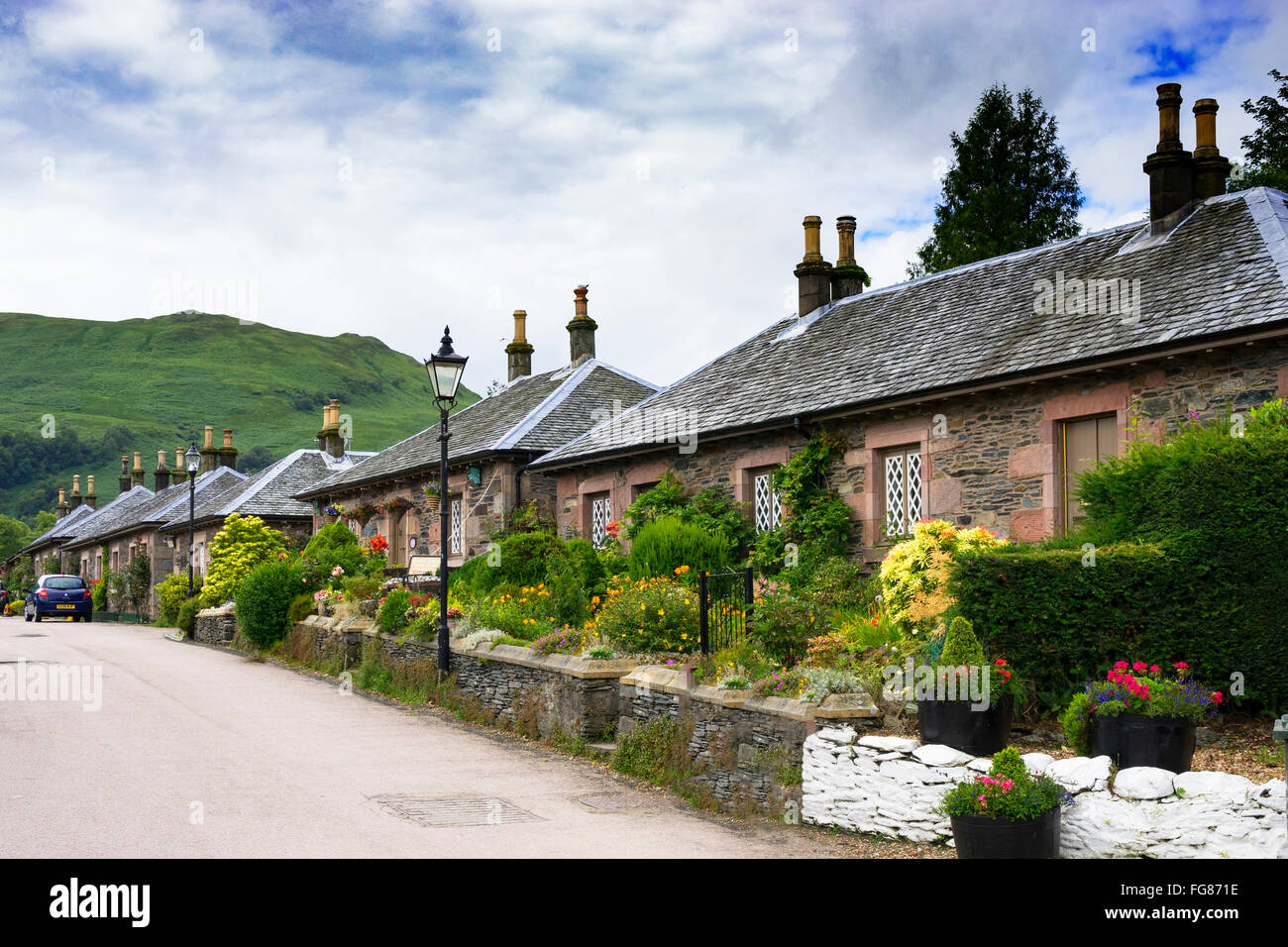 Old stone cottages in historic village of Luss in Argyll and Bute Scotland United Kingdom - Stock Image