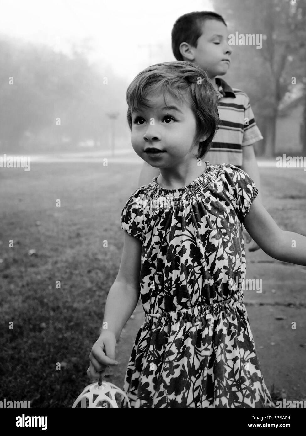 Girl And Boy Walking On Pathway - Stock Image