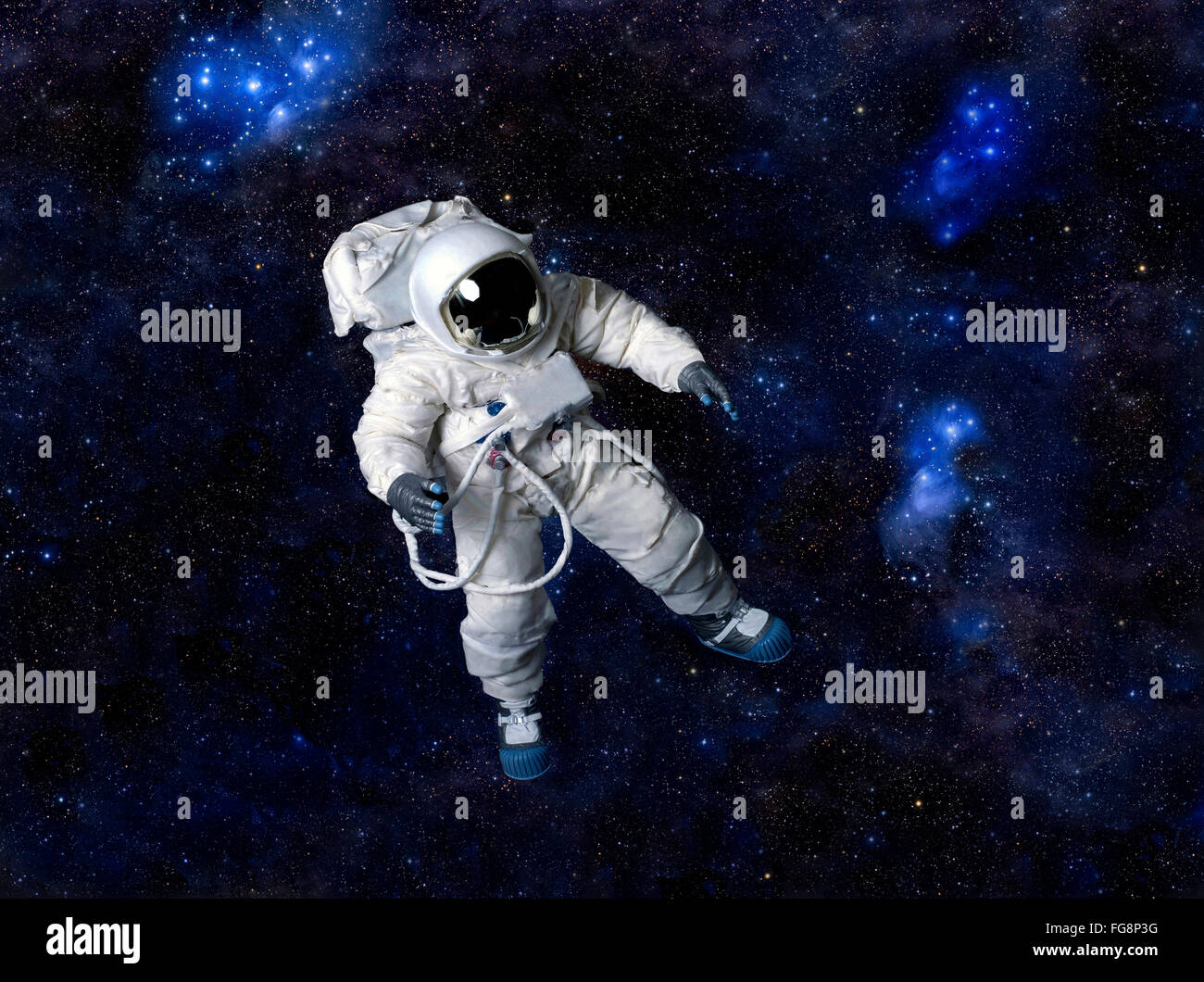 Astronaut floating in deep space - Stock Image