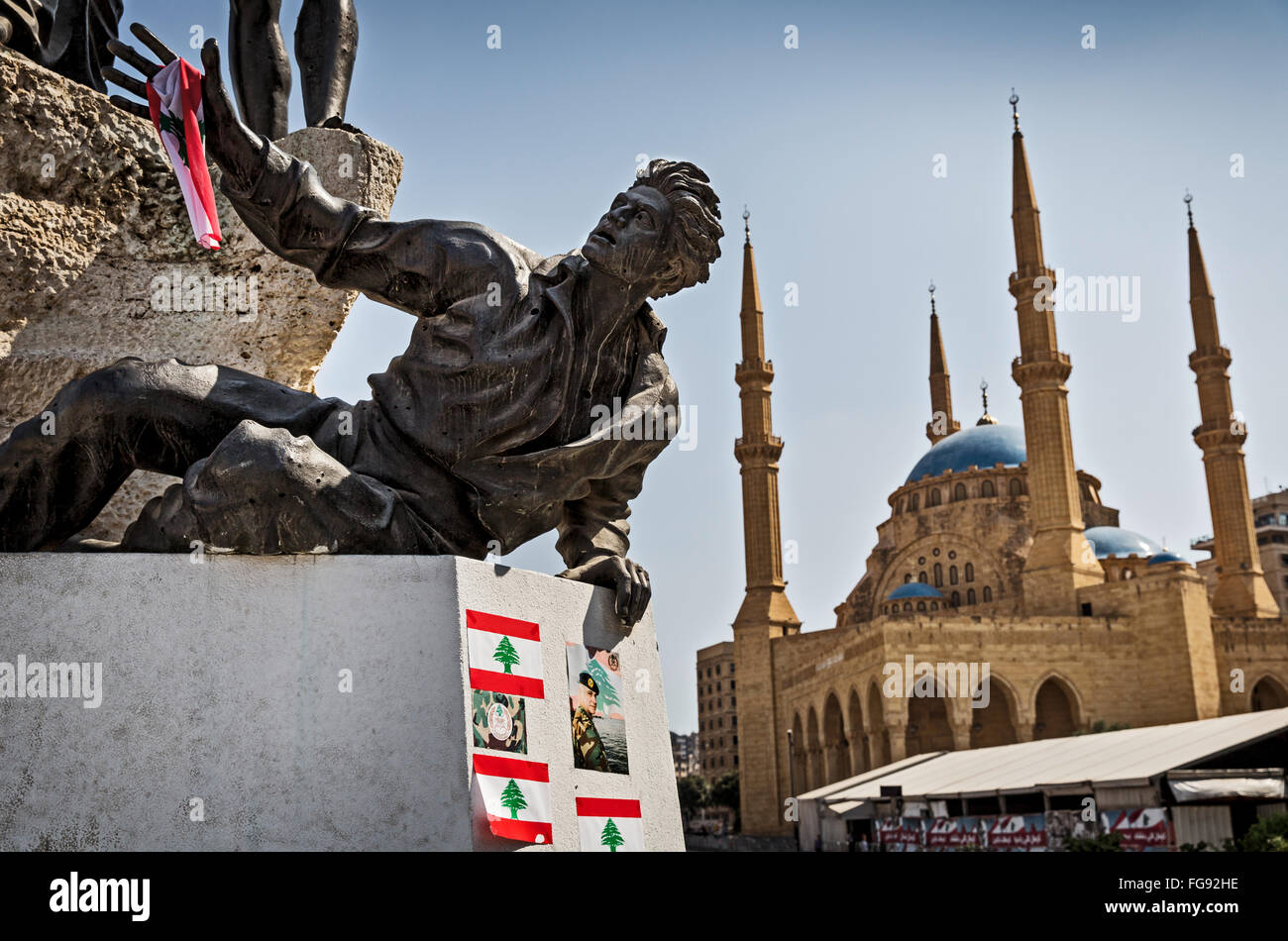 The shot-up during the Civil War Martyrs Monument and the Grand Mosque at the Martyrs square in Beirut. - Stock Image
