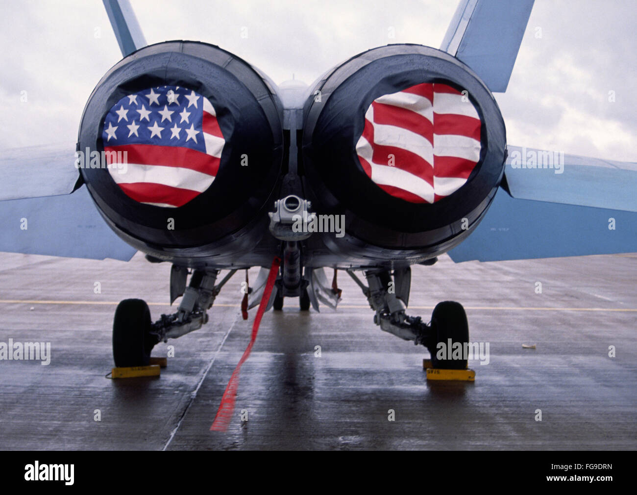 Patriotic American Flag covers on the rear of a USA F/A-18 Hornet fighter combat jet aircraft. Stock Photo