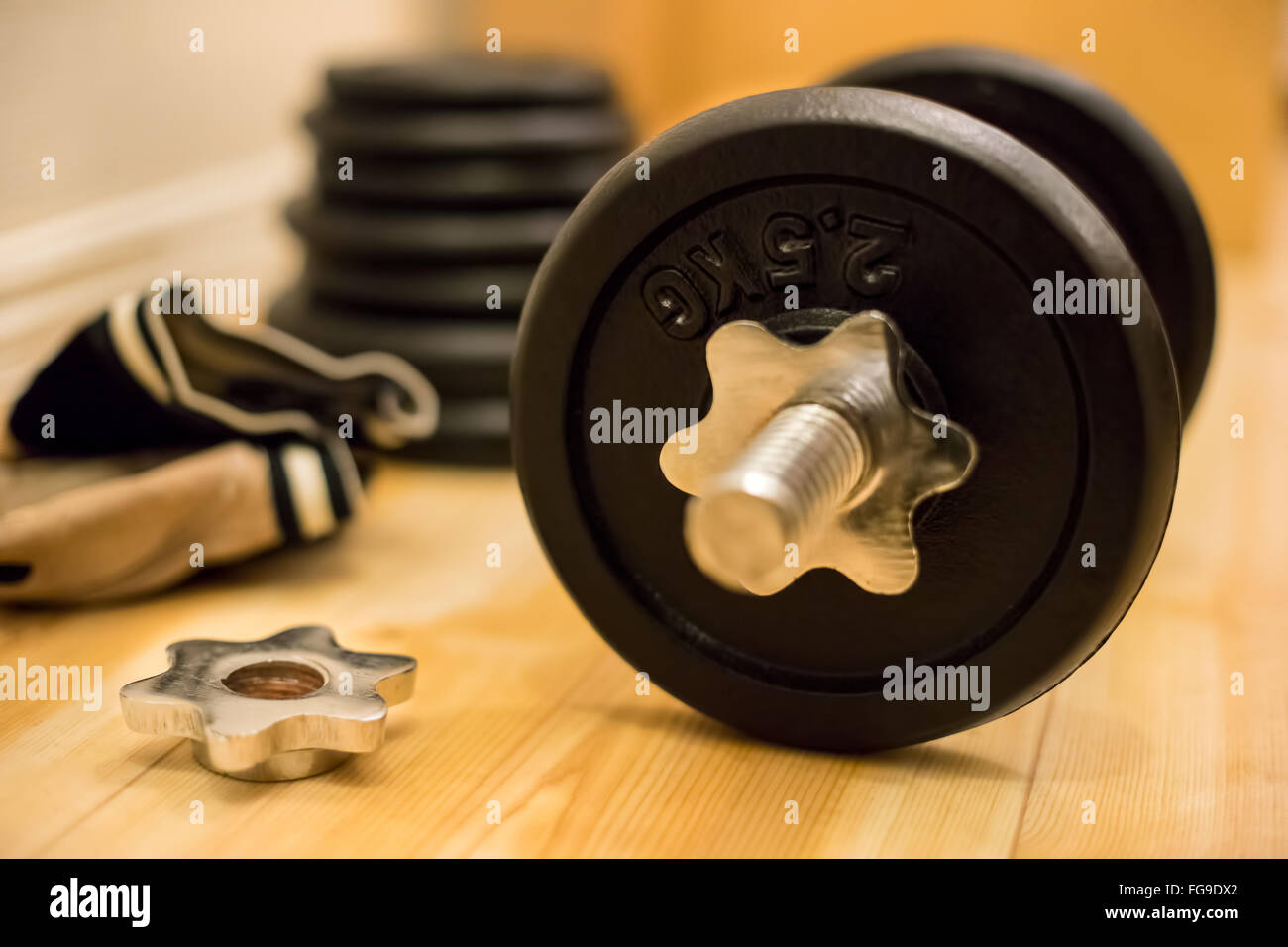 Close-Up Of Barbell On Hardwood Floor - Stock Image