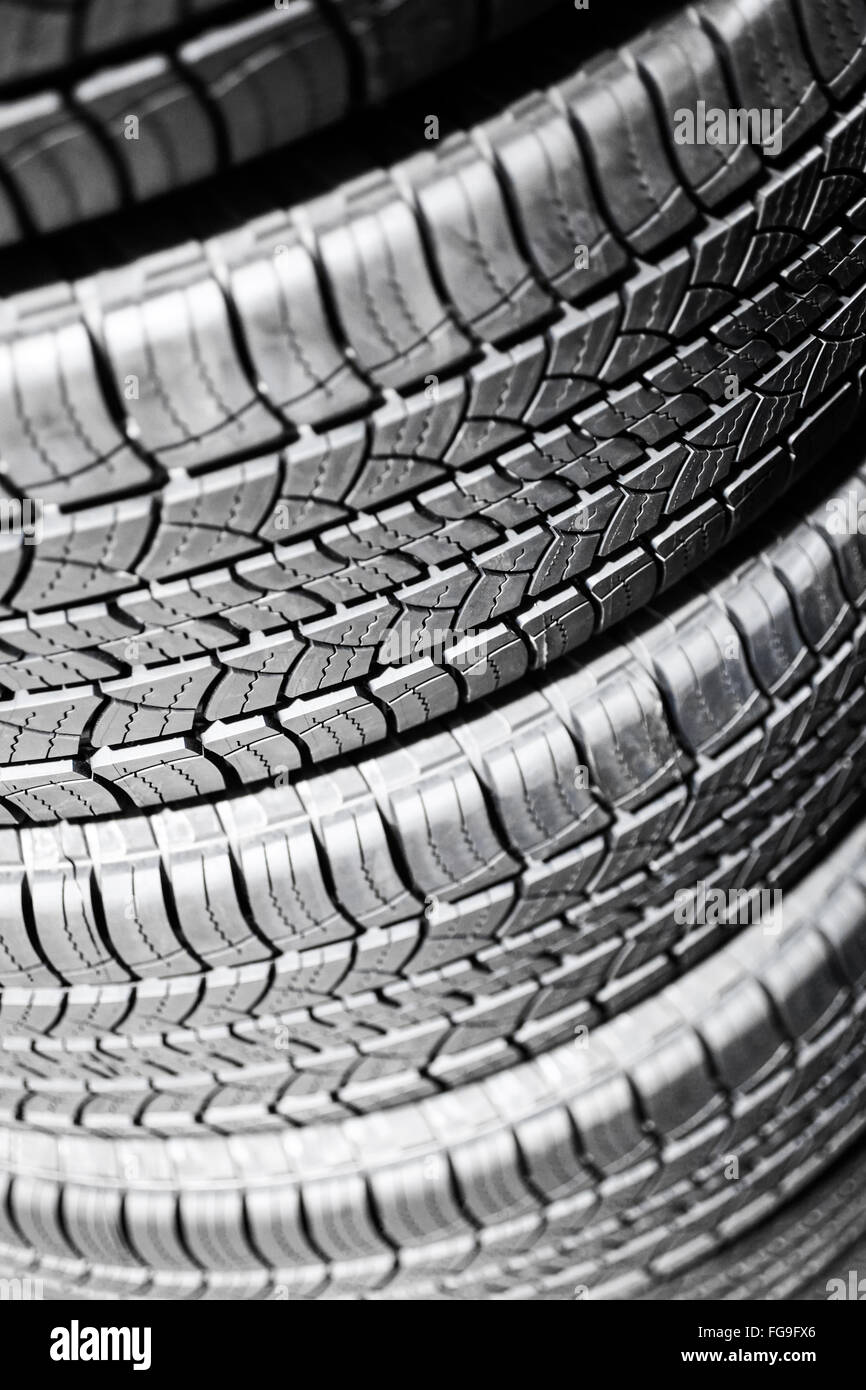 Car tires in a stack at an automotive repair service shop - Stock Image