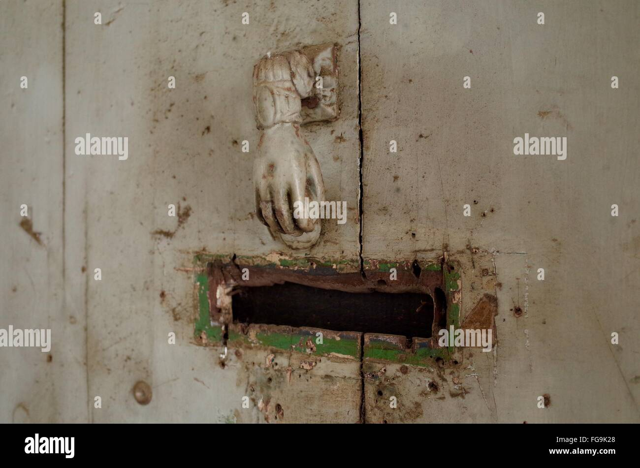 Old-Fashioned Doorknob And Mail Slot On Door - Stock Image