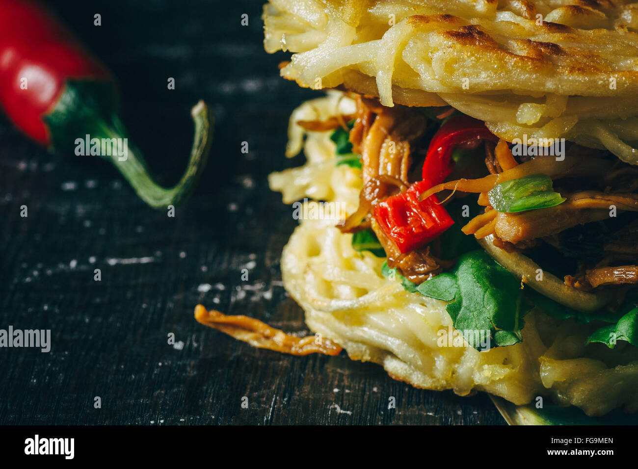 Cropped Image Of Fresh Ramen Burger With Red Chili Pepper - Stock Image