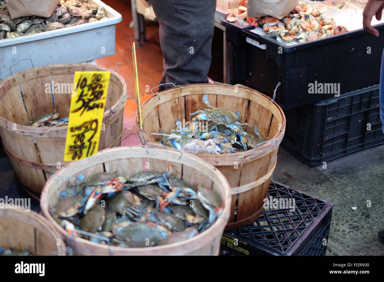 High Angle View Of Crabs In Containers For Sale At Fish Market - Stock Image