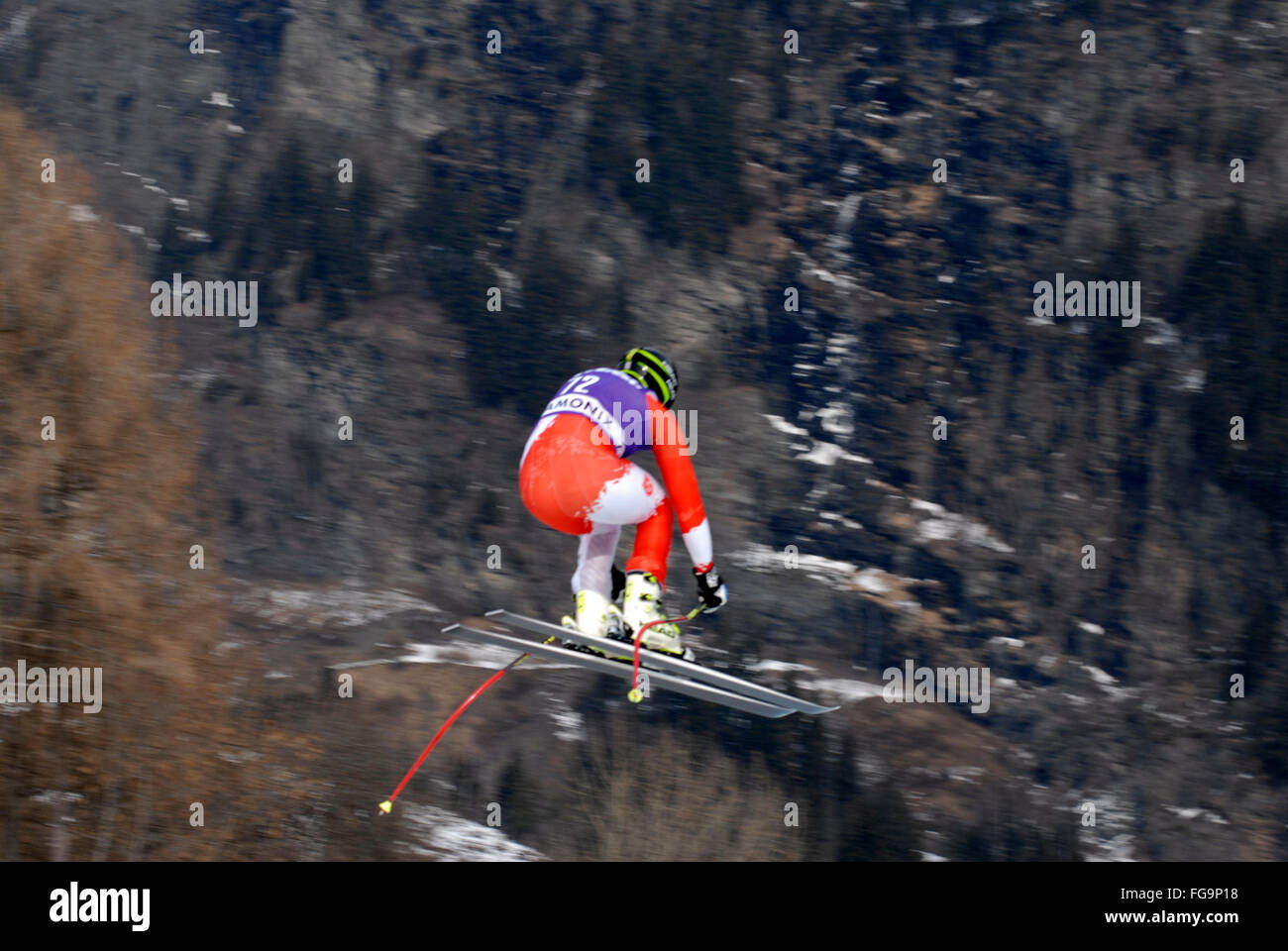 Mens downhill ski racer in the air - Stock Image