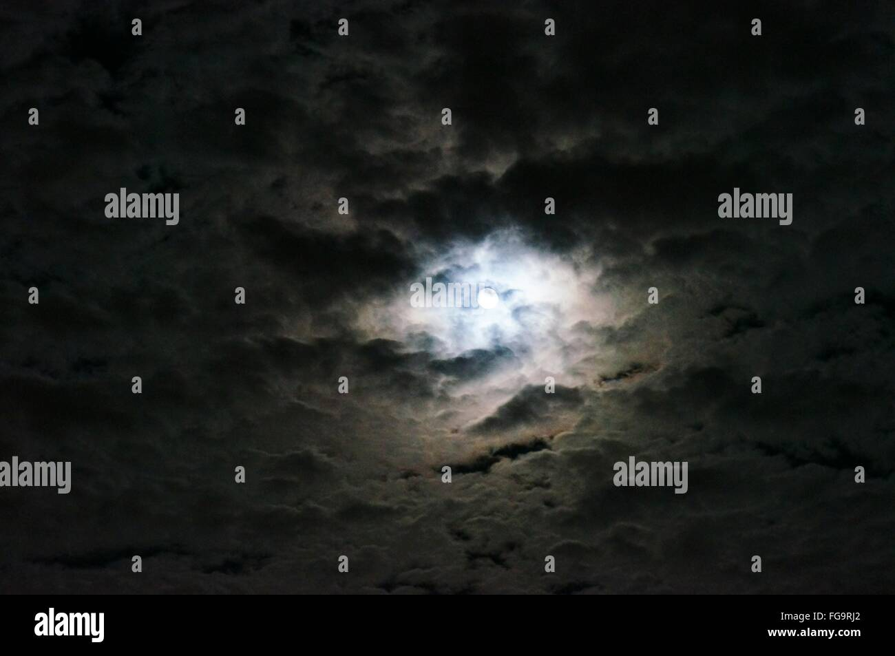 Low Angle View Of Cloudy Sky At Night - Stock Image