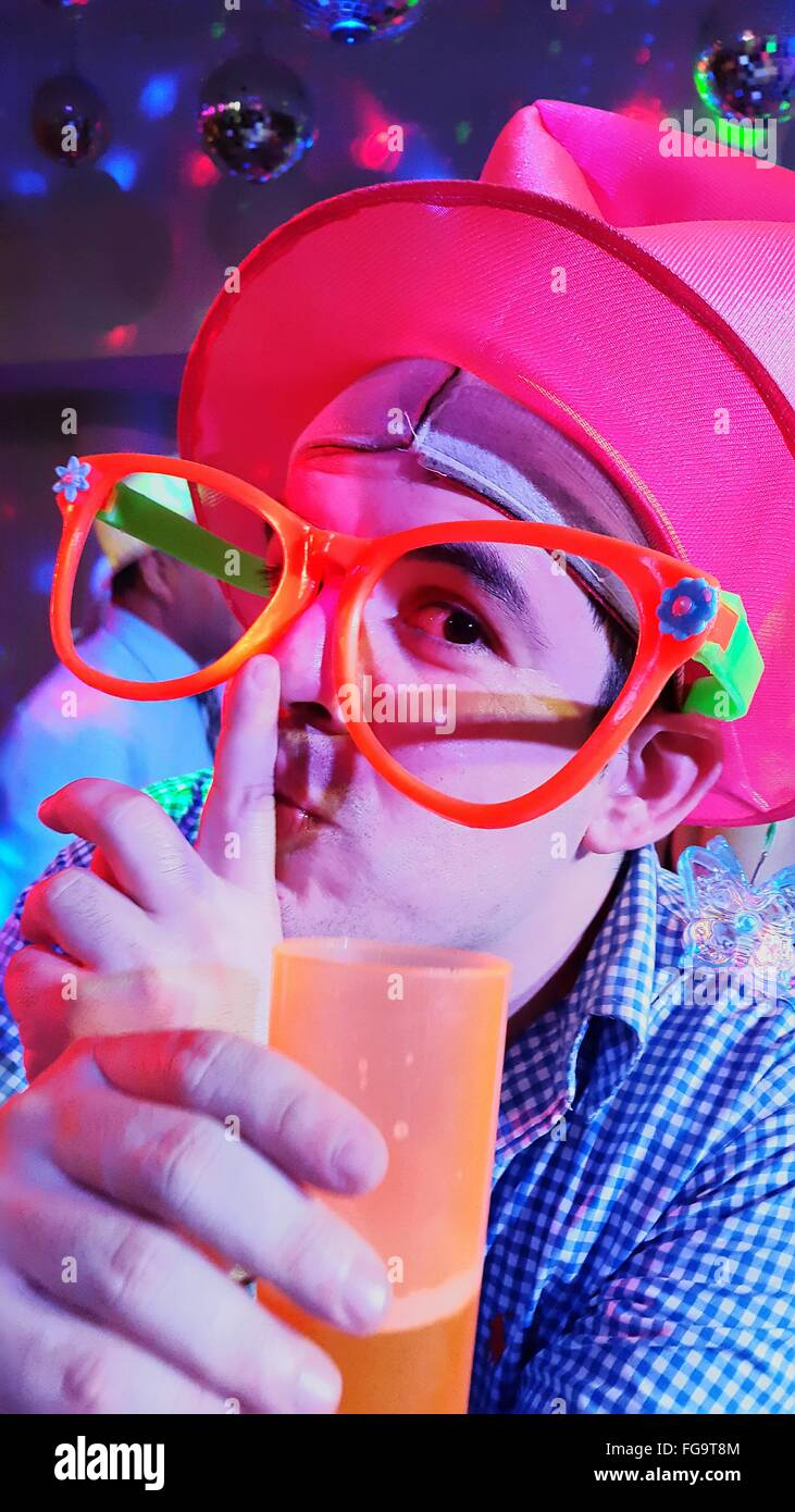 Portrait Of Man Wearing Novelty Glasses Gesturing At Party - Stock Image