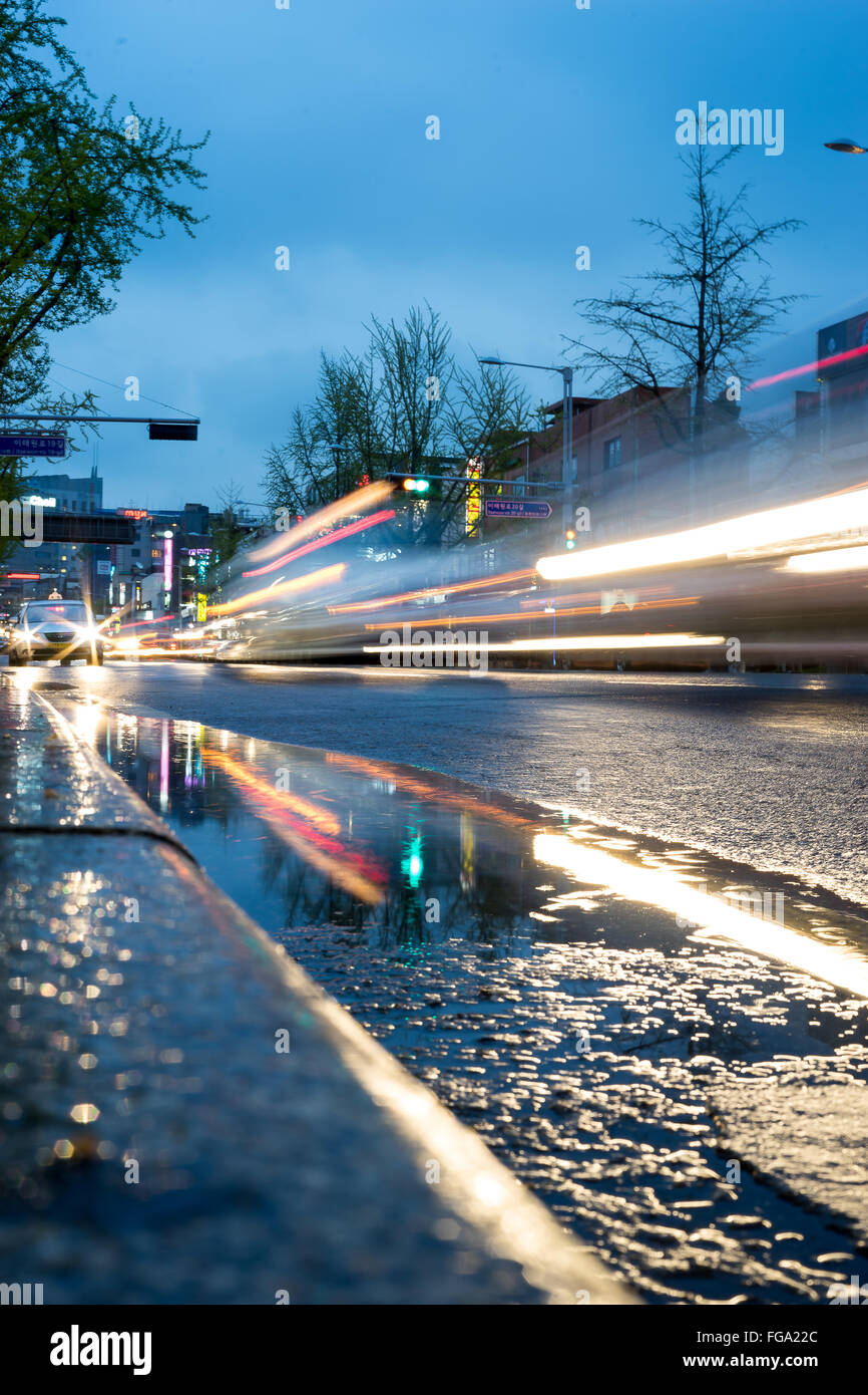Light Trails On Street In City Against Sky - Stock Image