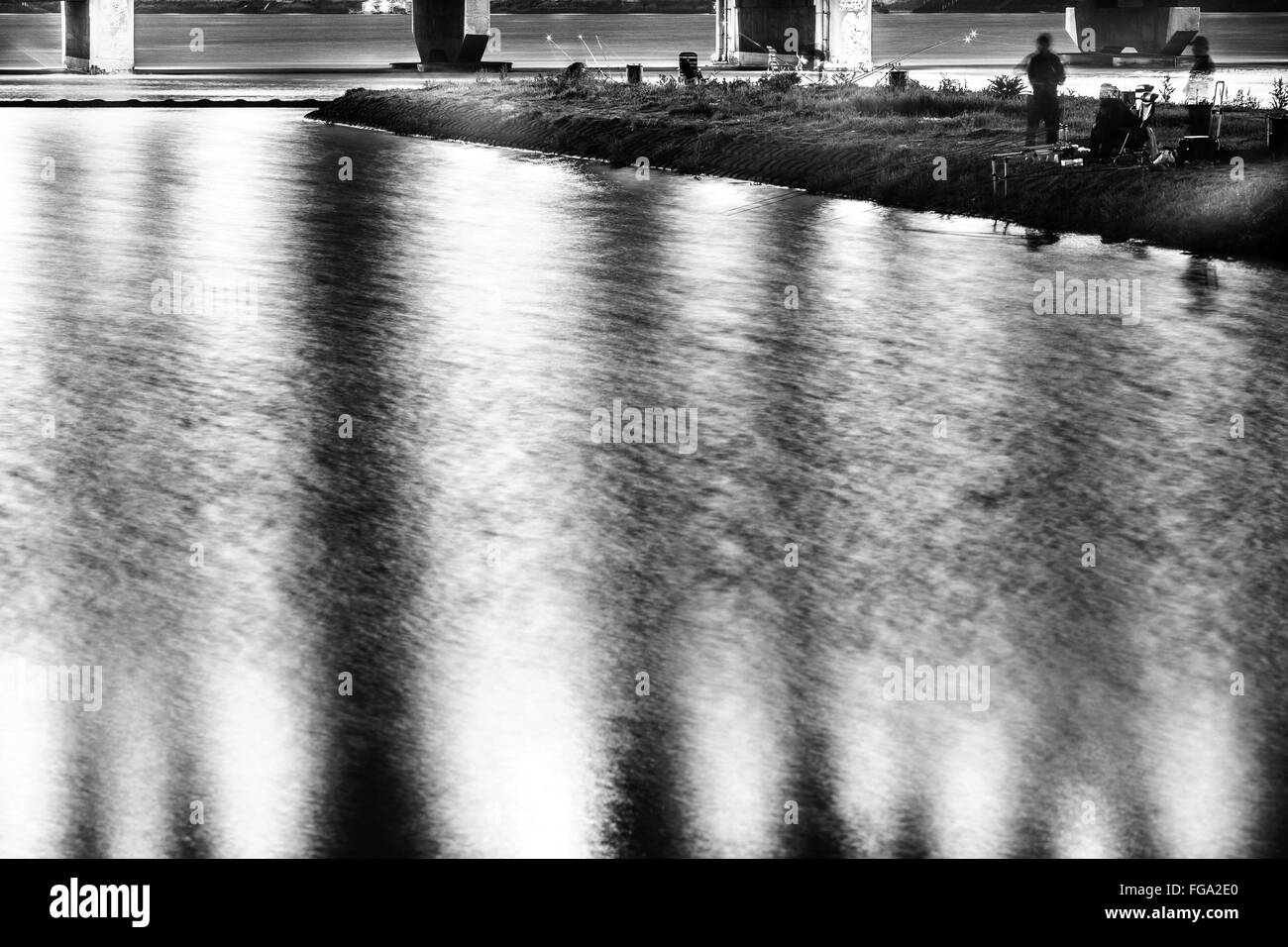 High Angle View Of River By Field At Night - Stock Image