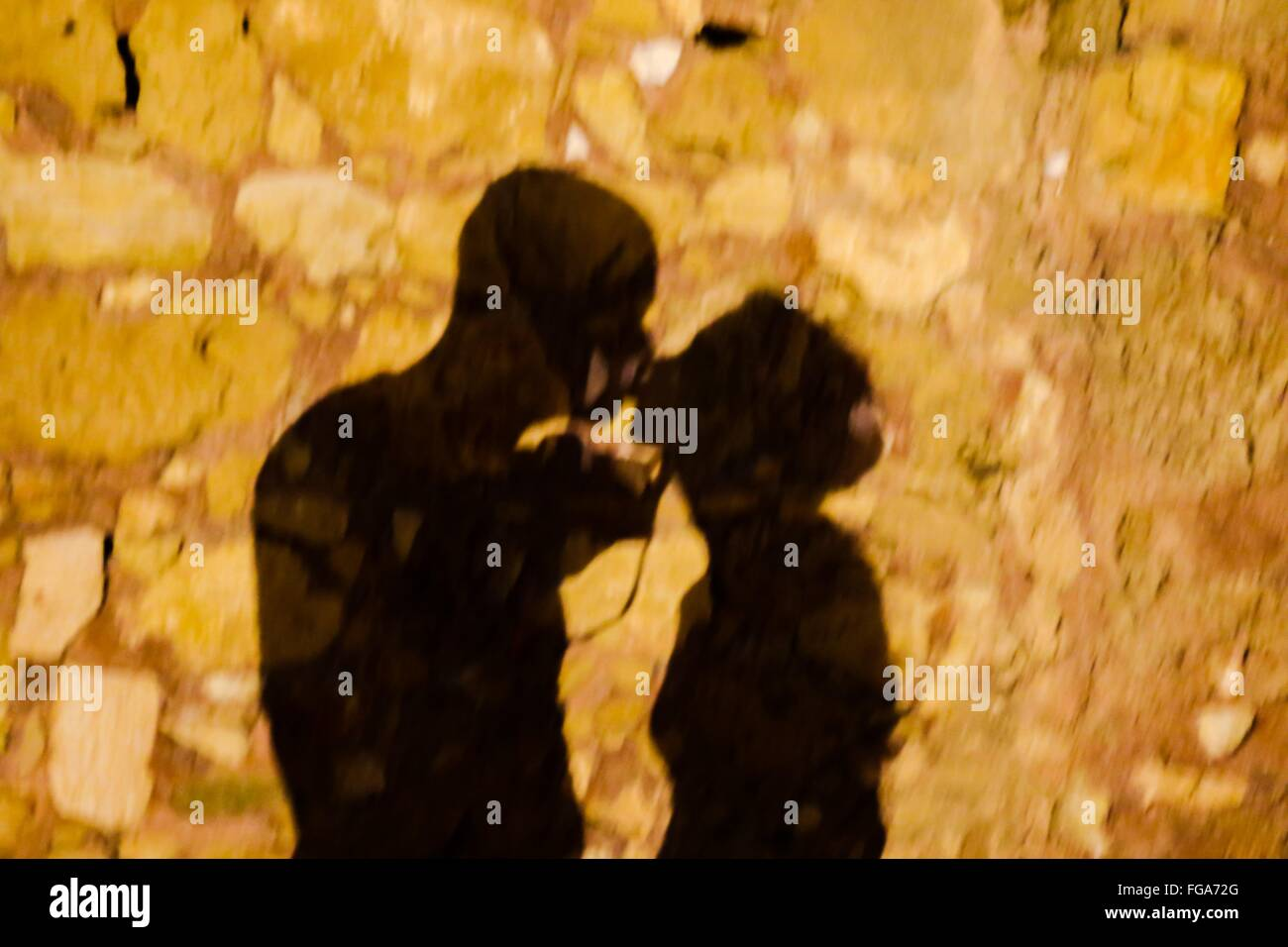 Shadow Of Kissing Couple On Street - Stock Image