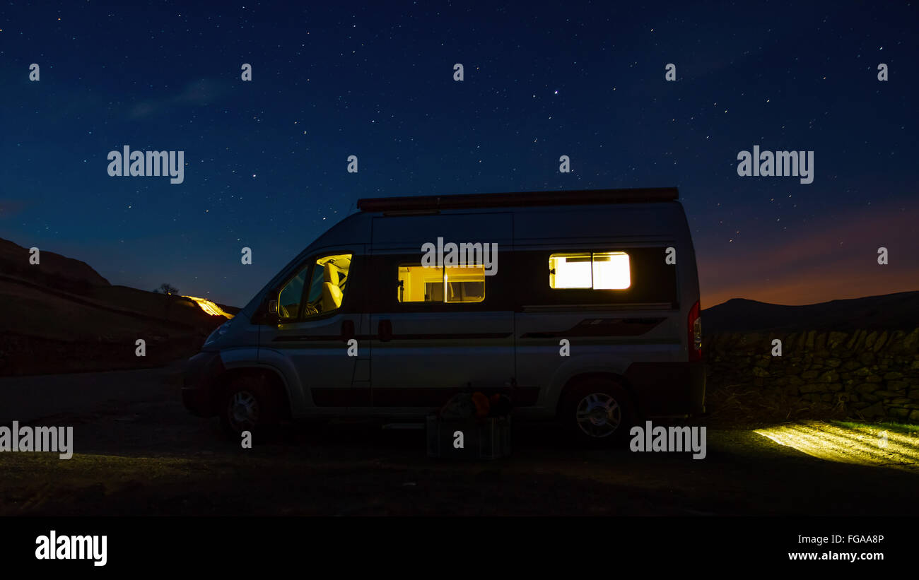 Hills, stars and sunset from a campervan in the Lake District, Cumbria, England, UK - Stock Image