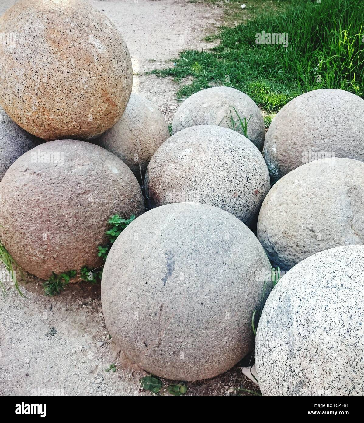 High Angle View Of Sphere Shaped Rocks On Field - Stock Image