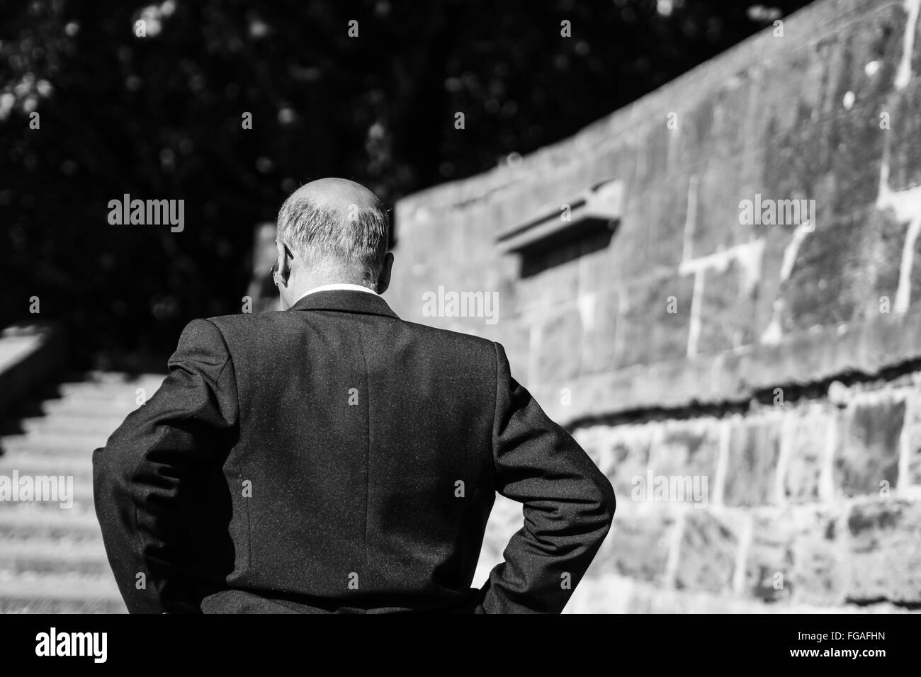 Rear View Of Man In Formalwear Standing Outdoors - Stock Image