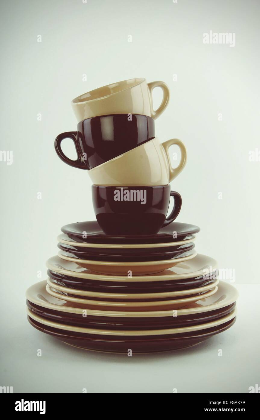 Stack Of Cups And Saucers Over White Background - Stock Image