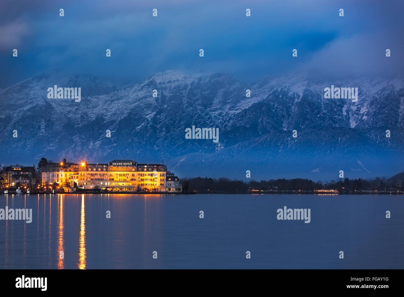 """ZELL AM SEE, AUSTRIA - JANUARY 05, 2016 - Grand Hotel in front of Steinernes Meer (""""Rocky Sea"""") mountain range at Stock Photo"""