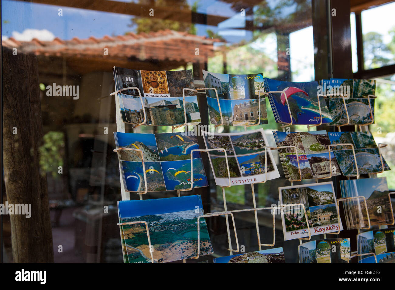 A stand of holiday postcards of Fethiye and Olu Deniz outside a shop, Turkey. - Stock Image
