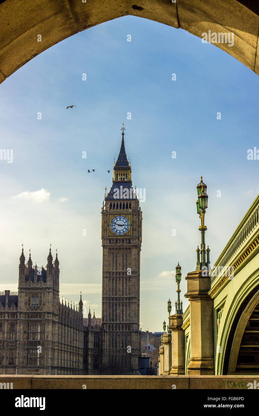 The beautiful Elizabeth Tower with the bells of Big Ben on top and the parliament near a bridge above the Thames - Stock Image