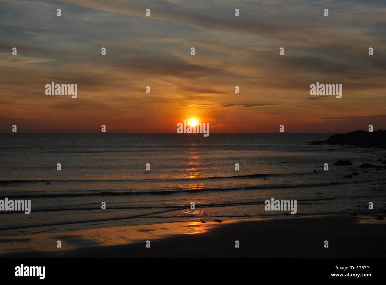 Scenic Shot Of Sunset Over The Sea - Stock Image