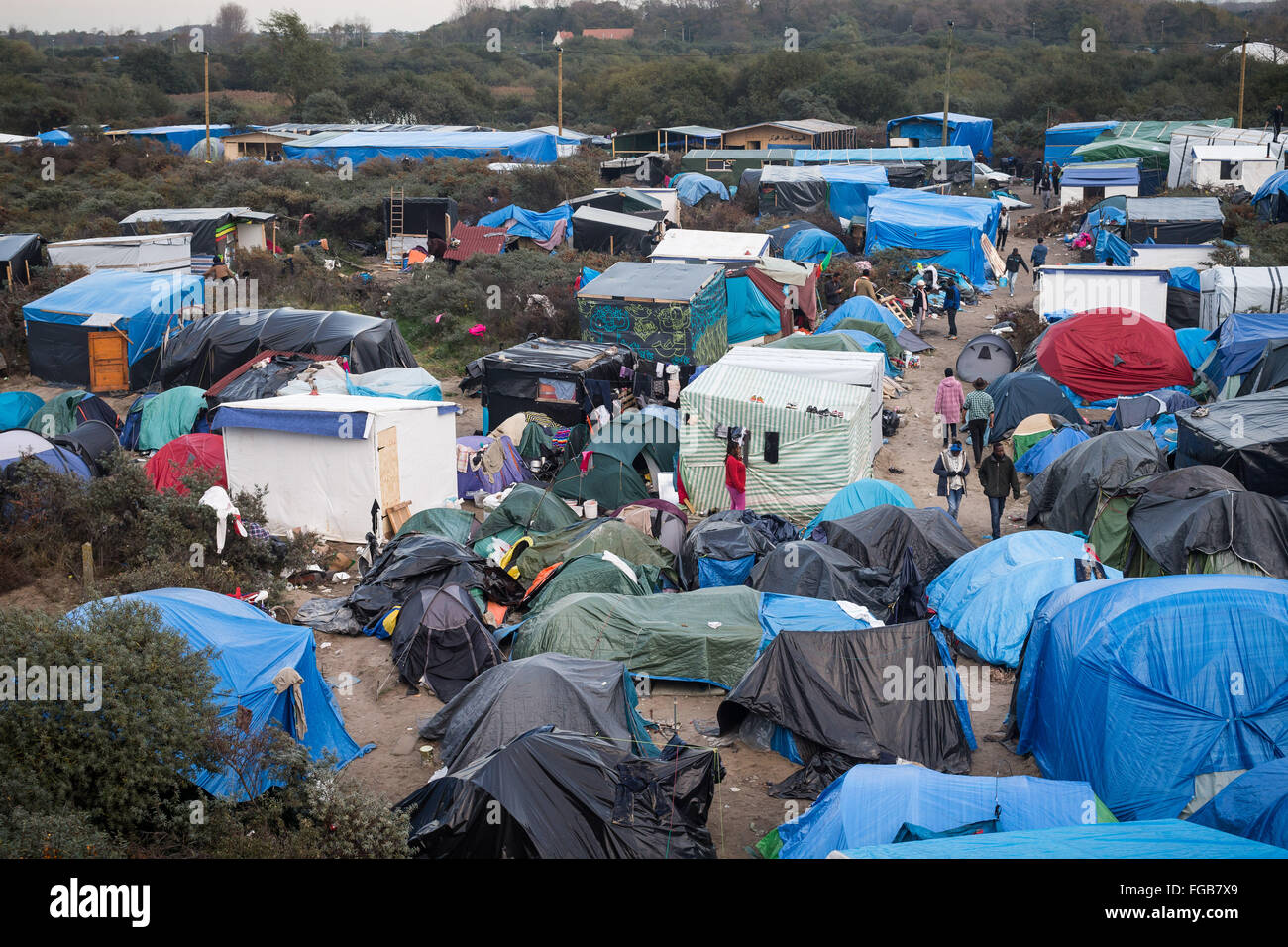 An aerial view of the Jungle refugee camp, Calais, France. People walk between the mass of tents and shelters. - Stock Image