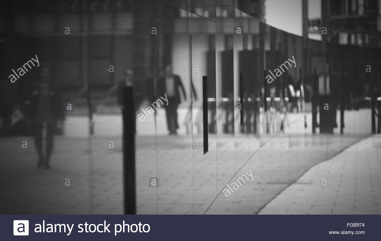 Reflection Of People On Glass Wall - Stock Image
