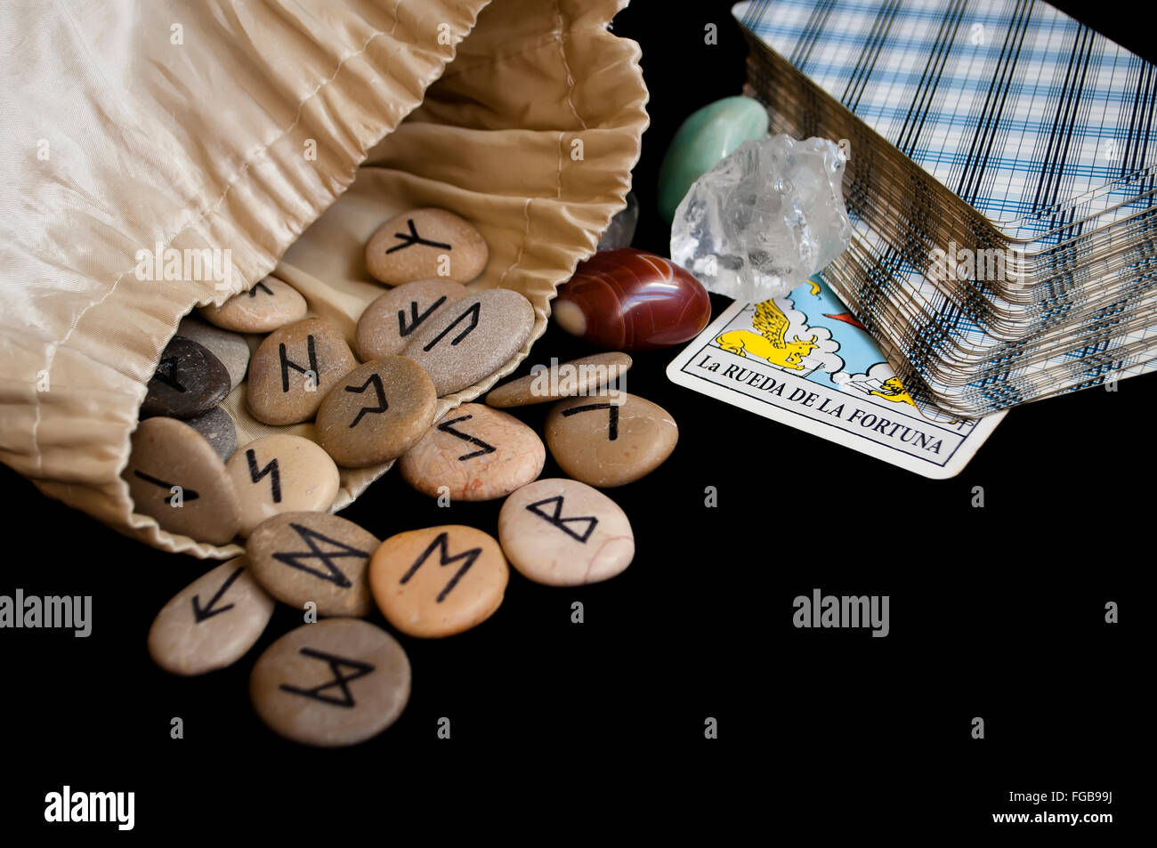 divination and prediction on runes and Tarot, mysticism or esoteric isolated on black background - Stock Image