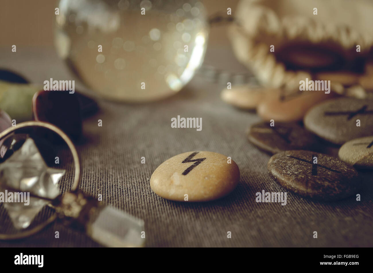 divination and prediction on runes and Tarot, mysticism or esoteric isolated on grey background - Stock Image
