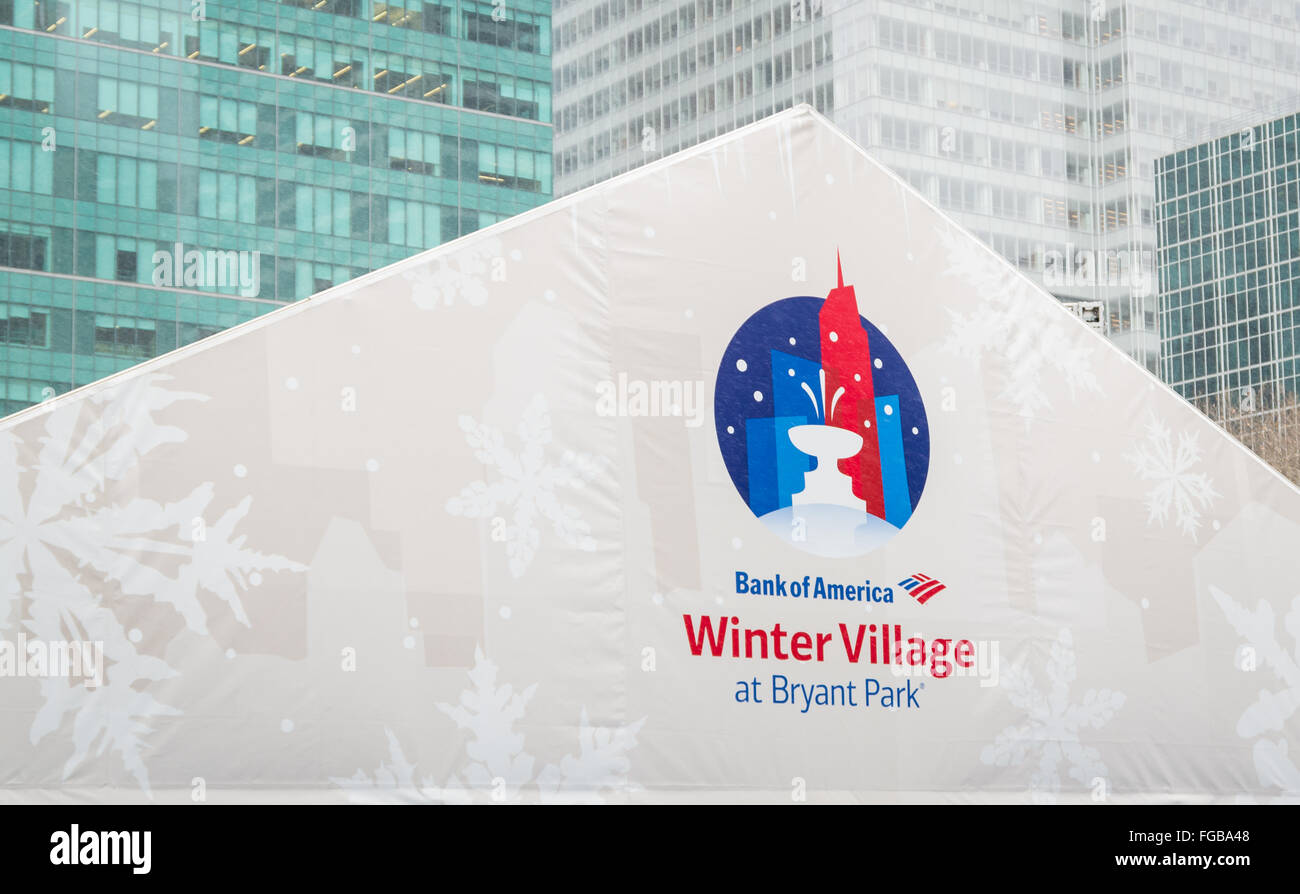 Close up of the logo on a tent at the Bank of America Winter Village at Bryant Park as it is snowing, New York City. - Stock Image