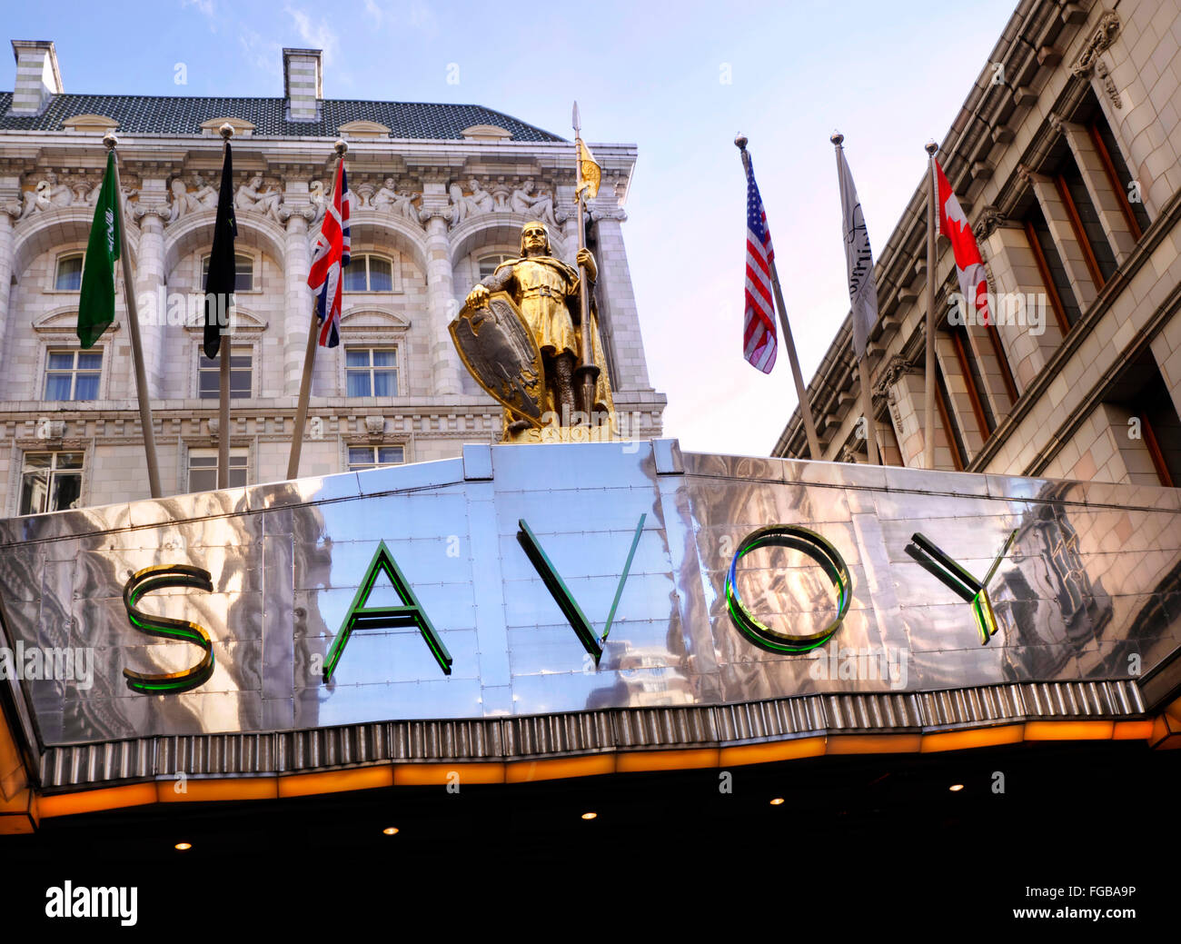 Exterior view of luxury Five-Star Savoy Hotel entrance foyer The Strand London WC2 - Stock Image