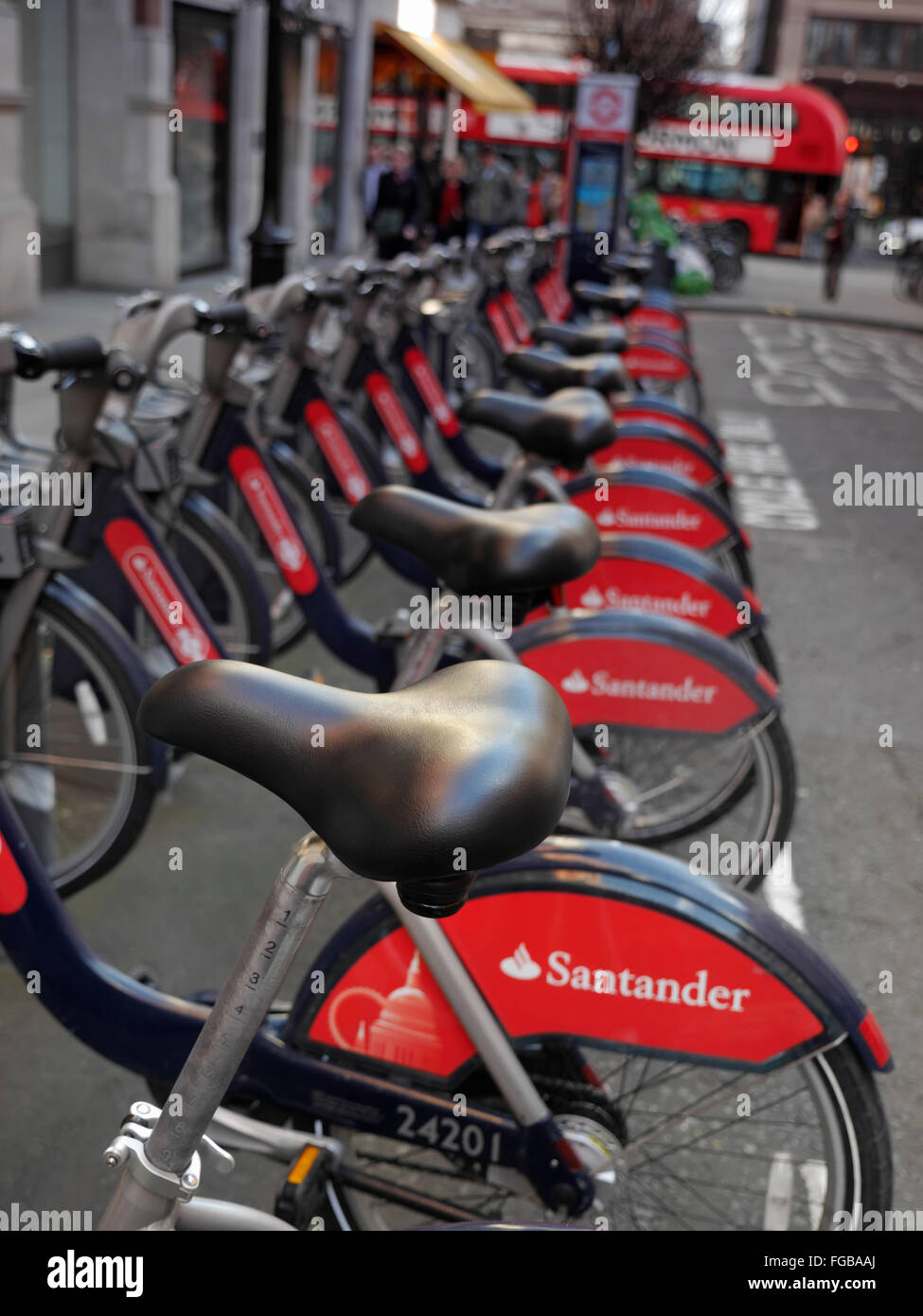 TFL London red rental hire bikes in Covent Garden with sponsor livery of Santander London UK - Stock Image