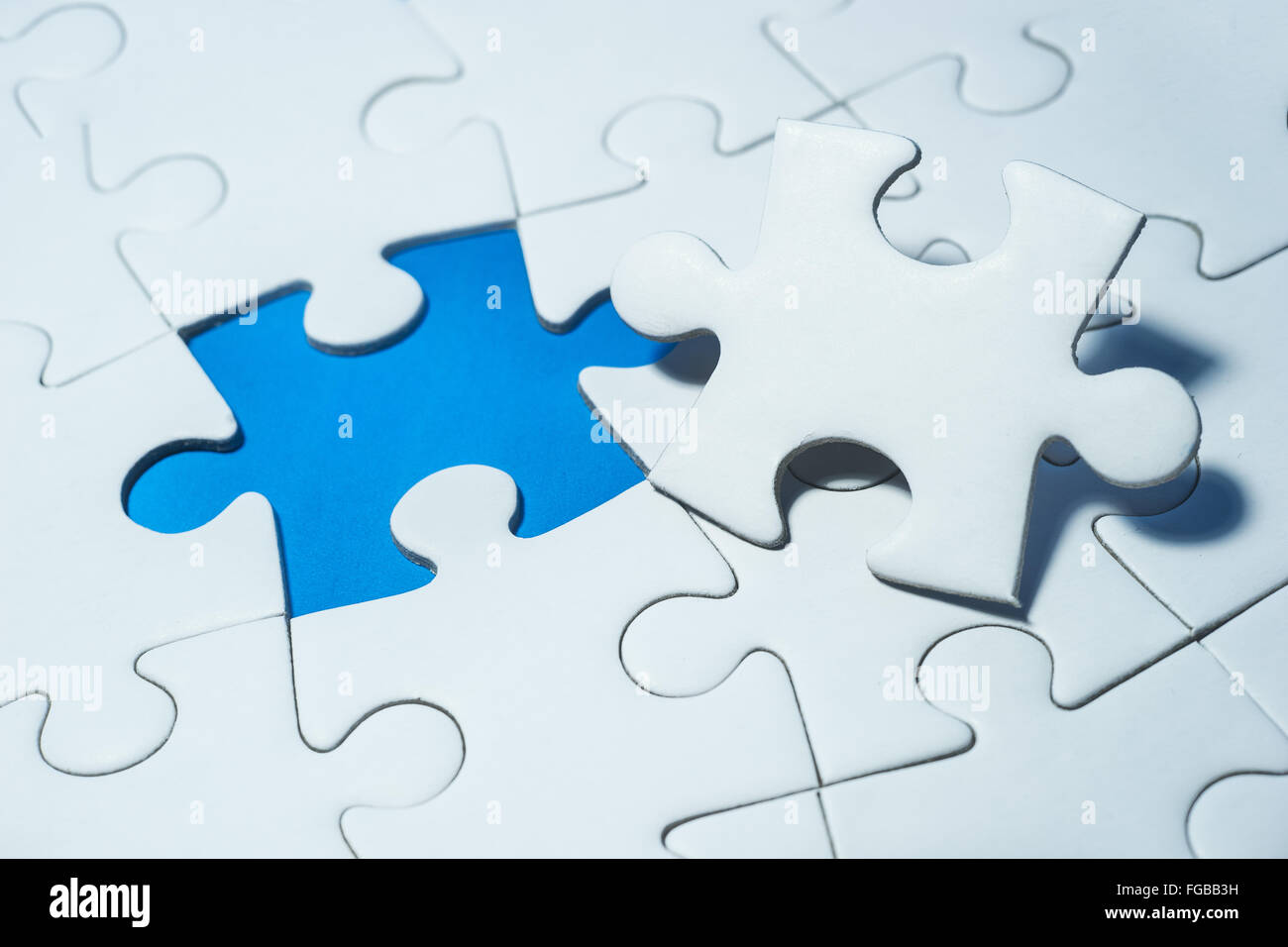 High Angle View Of Incomplete Jigsaw Puzzle - Stock Image
