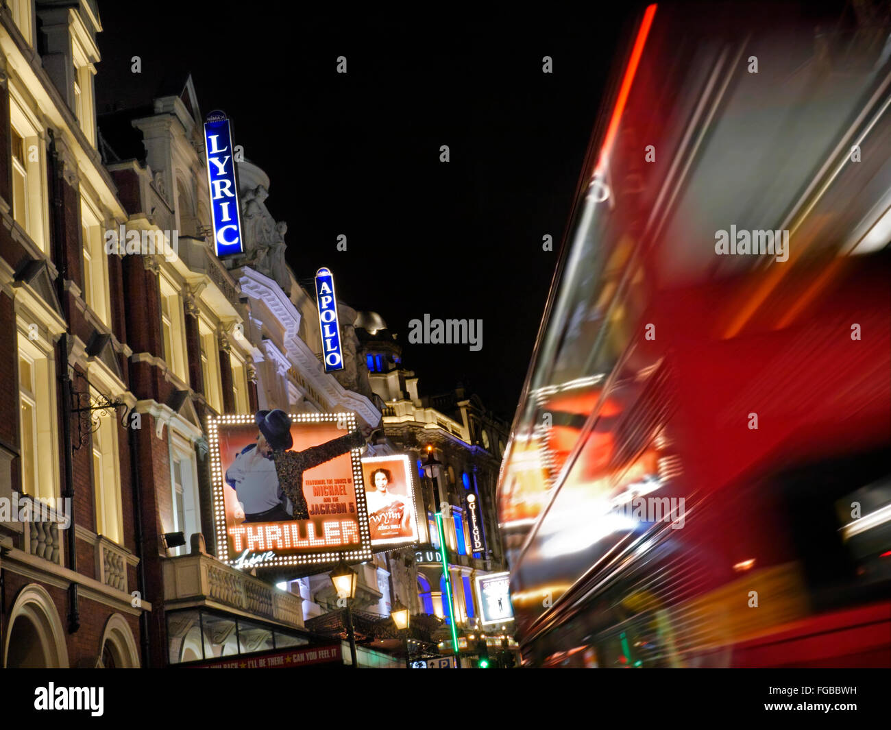 Theatreland busy with red buses in Shaftesbury Avenue West End London UK - Stock Image