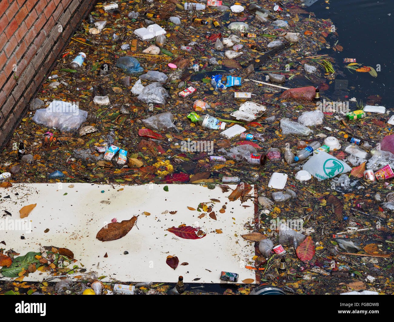 High Angle View Of Garbage Floating On Water - Stock Image