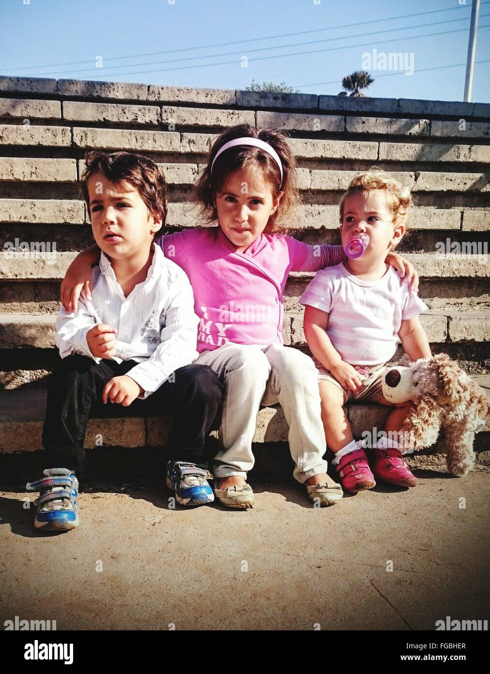 Happy Siblings Sitting On Steps - Stock Image