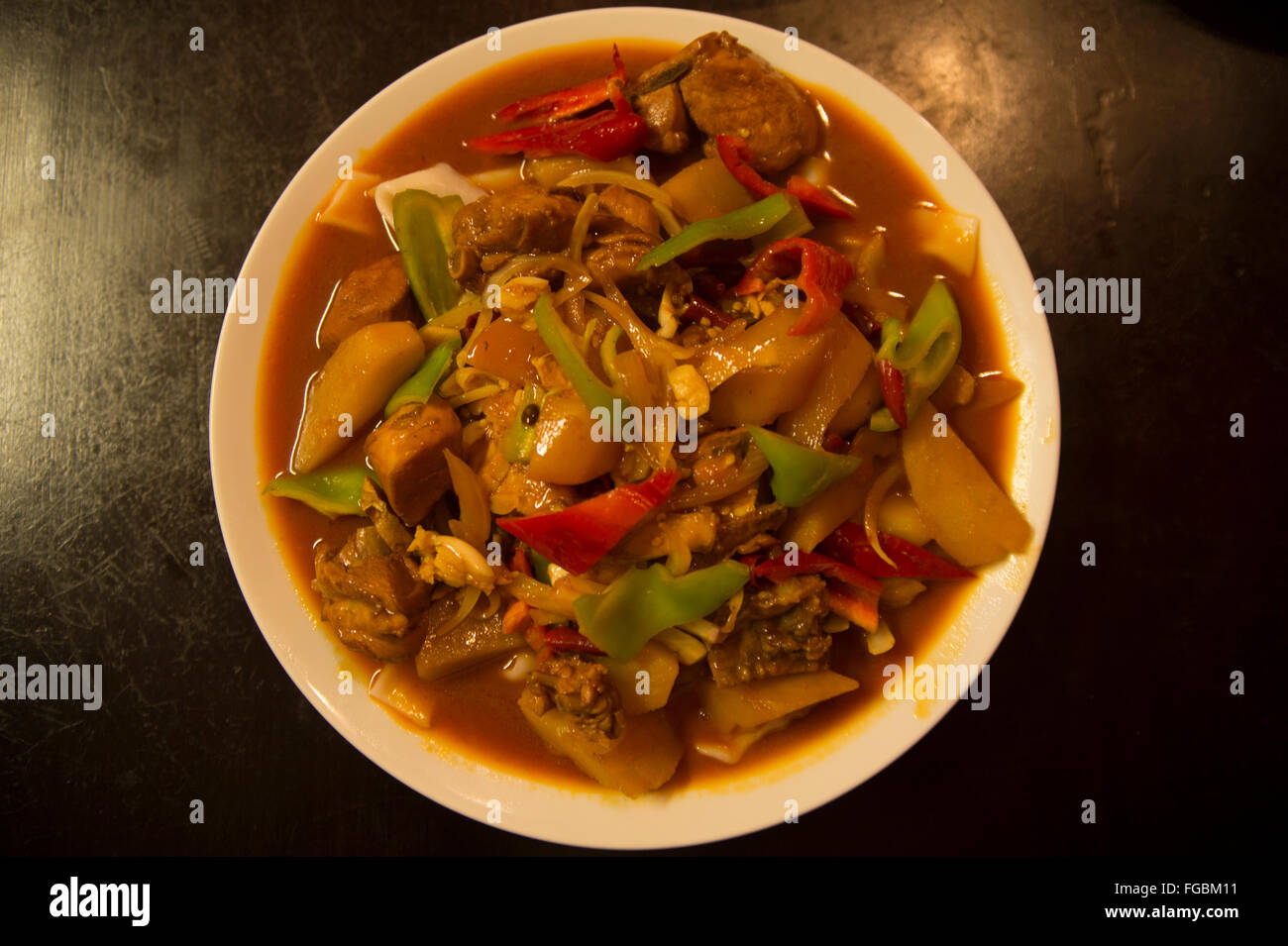 Uyghur cuisine: handmade noodles fried with chicken and vegetables - Stock Image