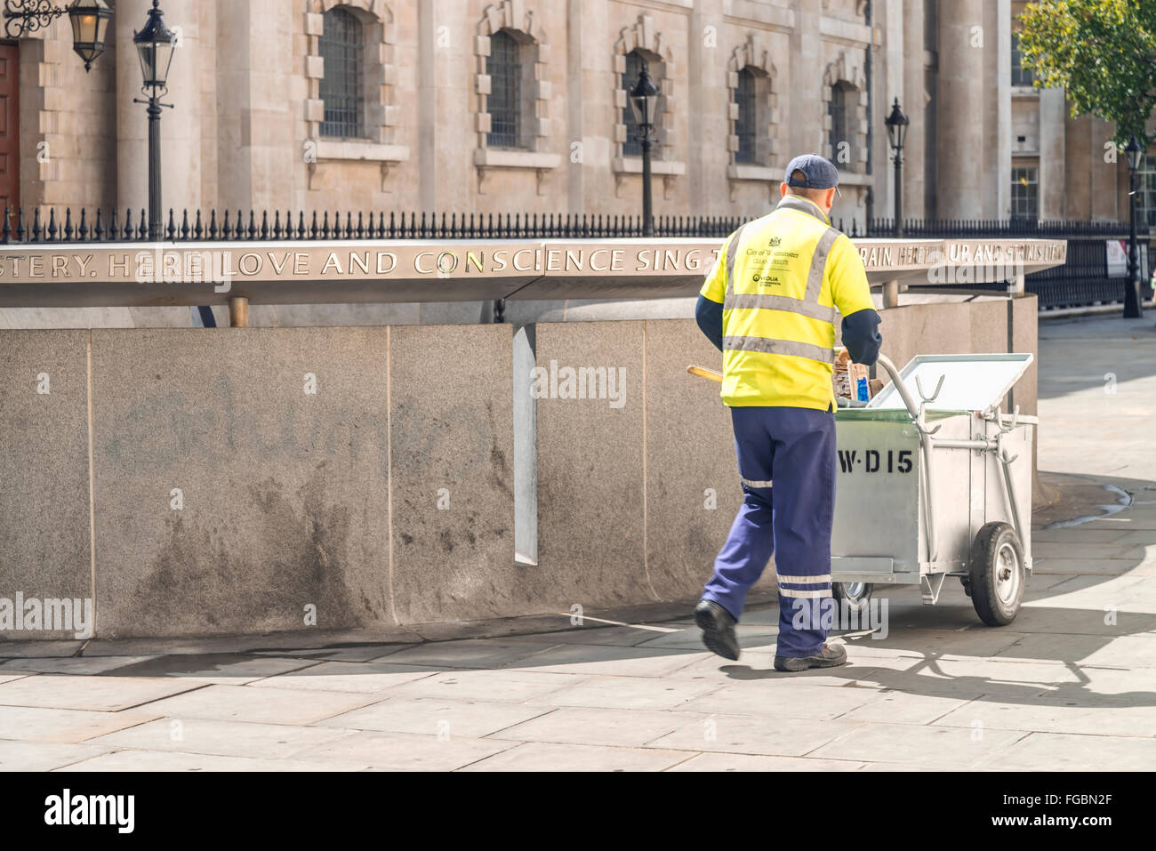 Street cleaner working in London city - Stock Image