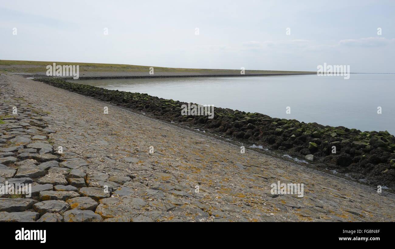 Part of the big ocean protection dikes, Breezanddijk in Holland, The Netherlands. Afsluitdijk is a 32km long dike. - Stock Image