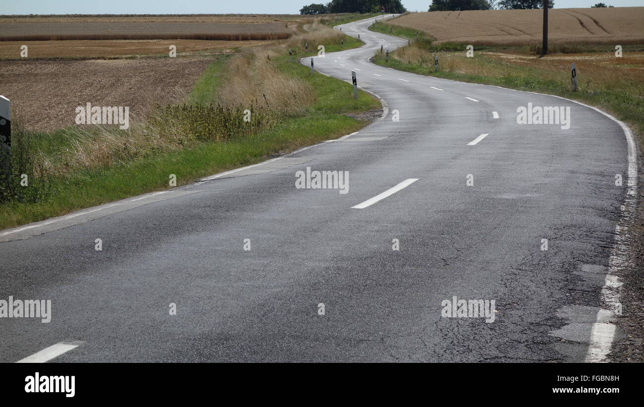 A perfectly winding road in Germany - Stock Image