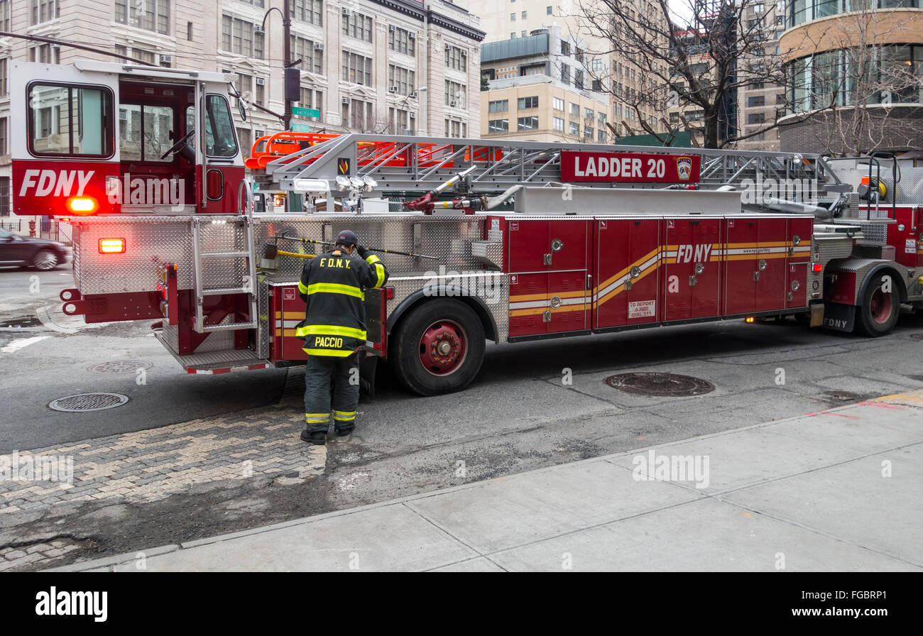 Hock and ladder firetruck and firefighter in New York City, Ladder 20 - Stock Image