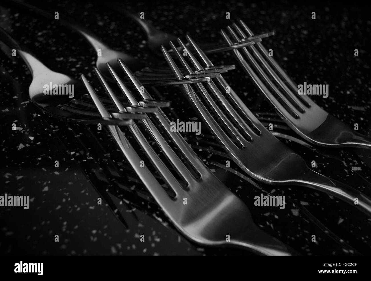 Close-Up Of Crossing Forks On Table - Stock Image