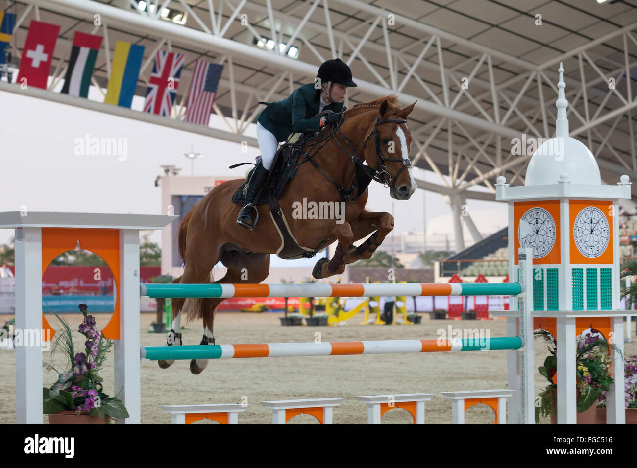 Rider competing in Show Jumping competition at CHI Al Shaqab 2014 Stock Photo