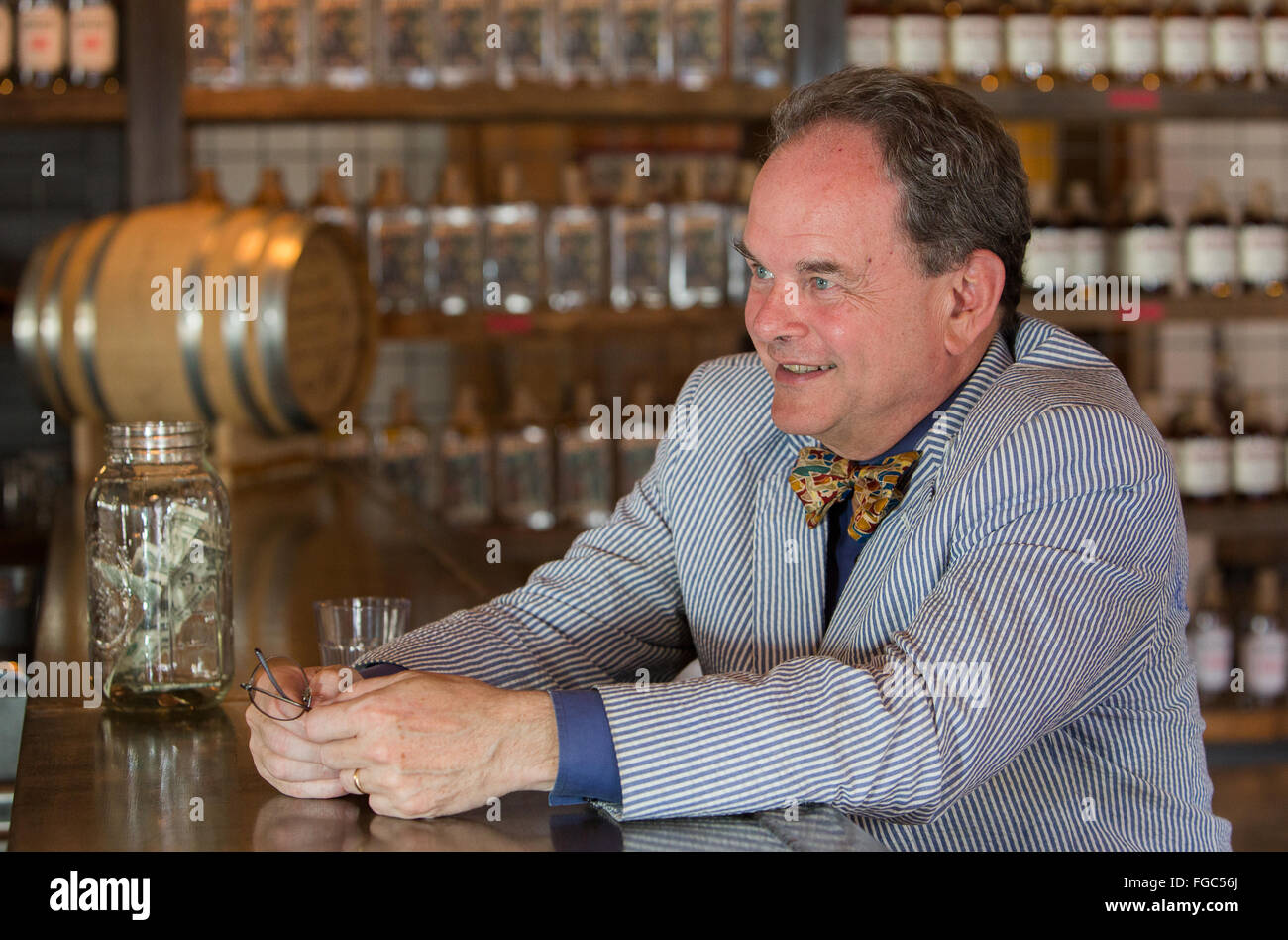 Southern Gentleman in bar with bowtie. - Stock Image