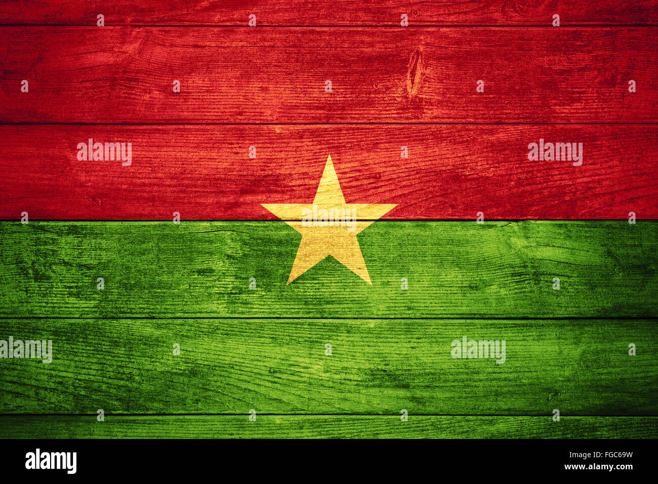 flag of Burkina Faso or  banner on wooden background - Stock Image