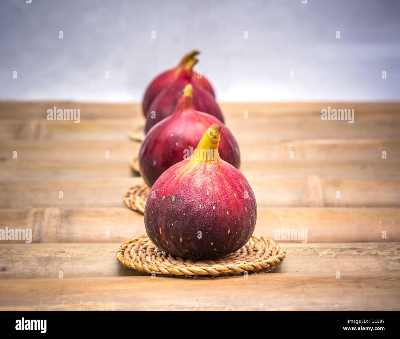 Fig--Black Genoa Gene, Ficus Fruit on Bamboo Table - Stock Image